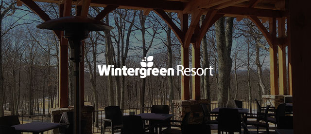 Wintergreen Resort logo over an image of the restaurant dining tables with a fall view of aspen trees faded out.